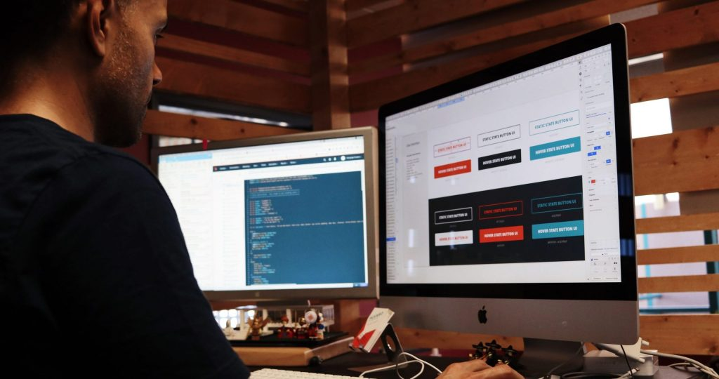 man using Apple computer