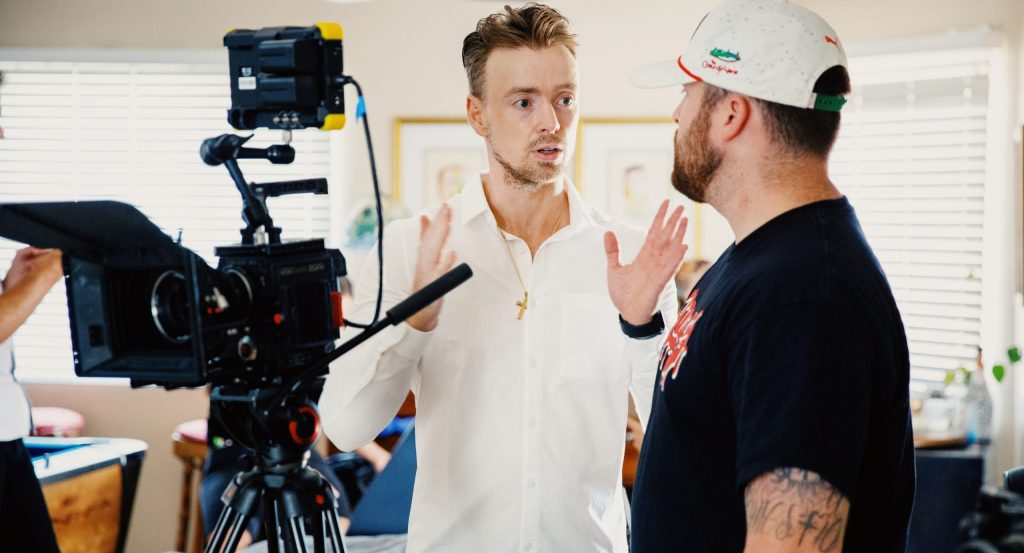 Gordon Cowie films and Revi Video on set of a TV pilot.